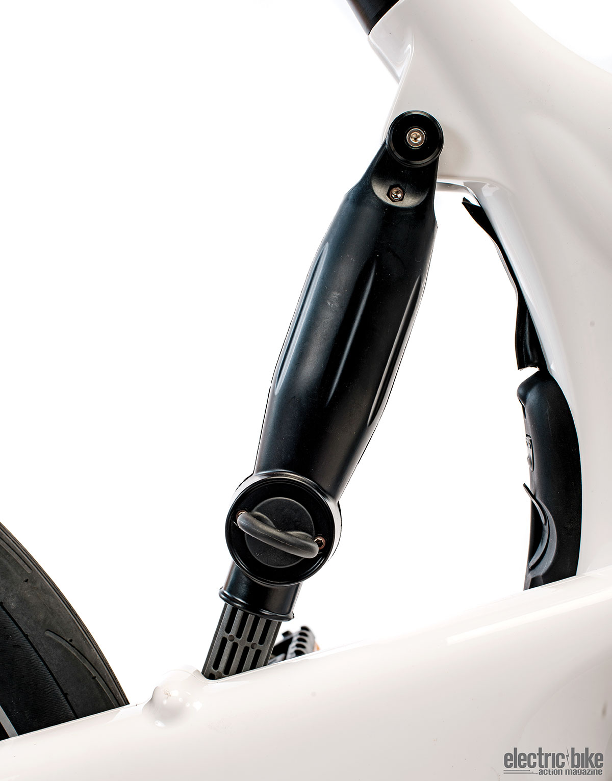 The brace in the rear provides 2.5mm (1 inch) of travel, enough to take the small bumps out.