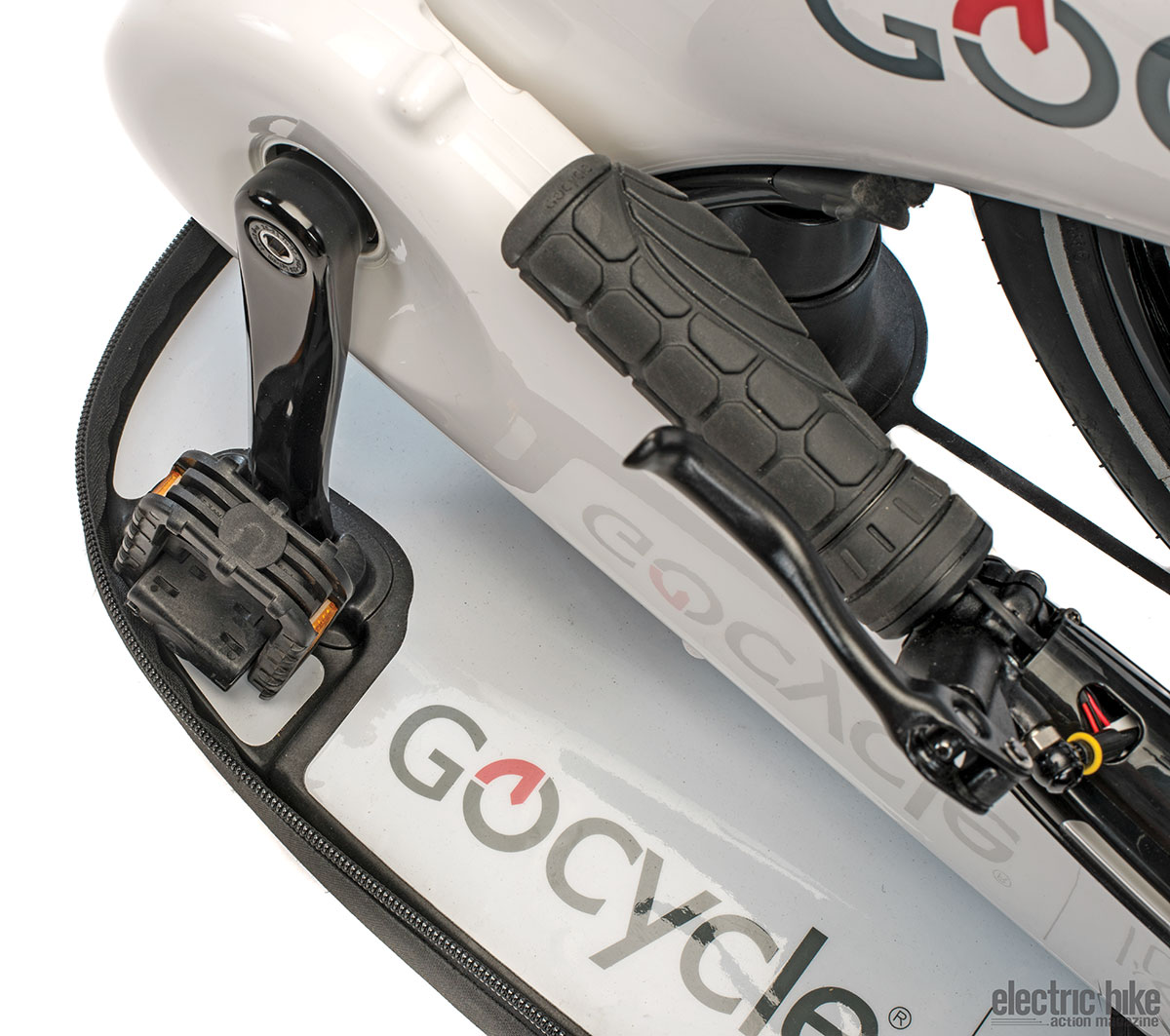 (Above) There is a lot of engineering in every detail of this bike. (Right) The G3 folds into a docking base with a tiny footprint. It's perfect for apartment dwellers.